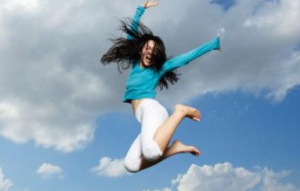 young lady jumping in midair
